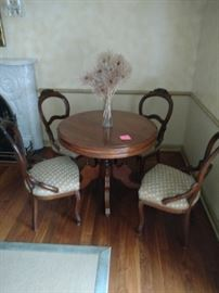 Fantastic Victorian round walnut parlor table and chairs