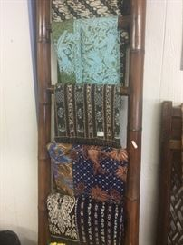 Batik textiles, bamboo ladder, carved lattice work 19th century screen.
