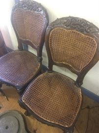 Two of four matching 19th century colonial side chairs made in southeast Asia for western market.