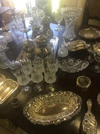 Table full of 19th and early 20th century glass and silver plate.