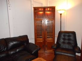 Mission Style Lighted Cabinets, these are seperate units Black Leather Couch