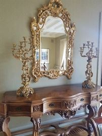 Oversized custom mirror and large candelabras with wood carved buffet