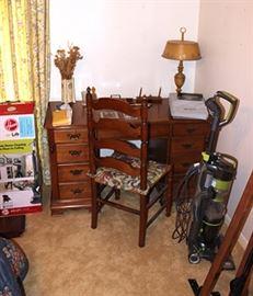 executive desk, ladder back chair, lamp,  vase, vacuum