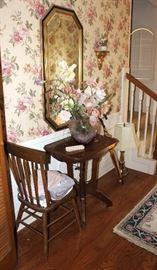 Antique table, chair, floral arrangement, lamp, mirror