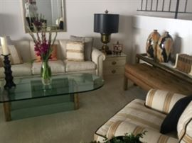 View of living room, Pace glass coffee table, Ethan Allen sofa, brass console, 1970's bench