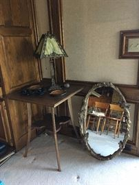 Antique table, heavy oval mirror with bird/twig frame