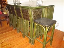 Fantastic bamboo/rattan bar with self storing bar stools.  Brought over from Thailand around 1970
