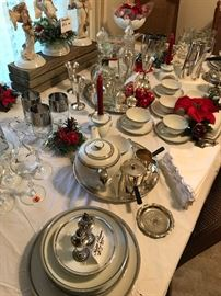 12 piece place settings of beautiful china w/ coffee and tea sets, on Dining Room table decorated for Christmas.