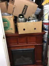 Portable electric fireplace/heater Storage unit #1 will be delivered and unpacked onsite.  Contents unknown.