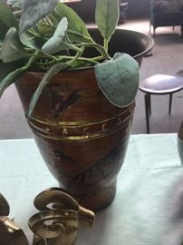 Metal vase with design.