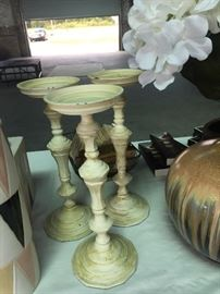 Candle sticks in distressed ivory.