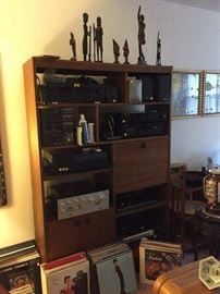 Entertainment unit, small representation of vinyl collection, assorted artwork et al.