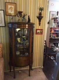 Curved glass Curio cabinet.