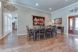 Hooker Dining Room Table, 6 side chairs, 2 arm chairs and buffet table.  Refinished in the past 6 months with new leather seats on the chairs.  Tapestry on the wall is also for sale.