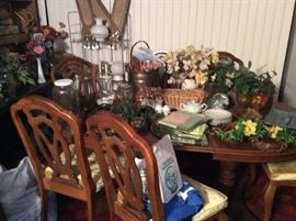Six seat dining room set.   Lots of floral arrangements