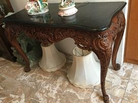Lovely carved Library Size Table with black marble top with curved edges