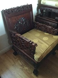 Two side chairs with dragon arms, each has seat and back cushions, just removed to show carvings
