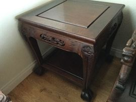 One of a pair of end tables that matches Living Room Suite of fine carved Chinese furniture