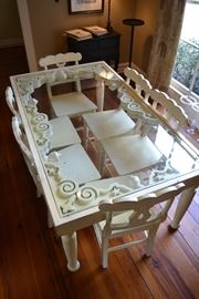 Really unique glass top dinning table with 6 chairs.