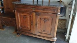 Antique carved, marble top French cabinet (carving matches the armoires) $900
