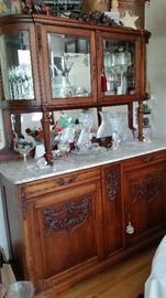 Antique carved french breakfront. Marble top, curved, beveled glass doors, mirrored back. Picture does not do it justice. $2,500