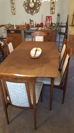 Dining table with 6 chrs.  - one leaf is in table here