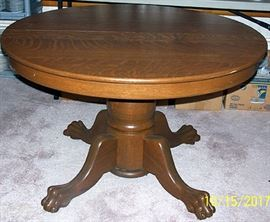 Oak claw foot table  ( 45 in. diameter)