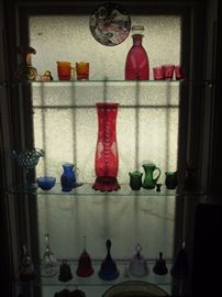 Glass collection in cranberry, green, cobalt and gold