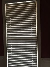 Blinds for sale throughout the home.