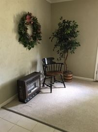 Space Heater, wood chair, silk ficus tree wreath