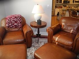 Very comfy leather club chairs with ottomans!