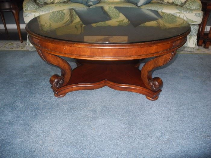Gorgeous round coffee table with glass on top from Toms-Price