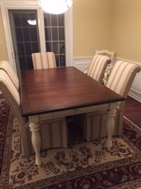 Farmhouse table like new with six upholstered chairs from Carson's