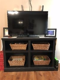"TV cabinet and wicker cabinets.  42"" flat screen TV.  Also available is a TV wall mount that holds up to a 65"" flat screen TV."