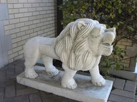 marble lion on pedestal