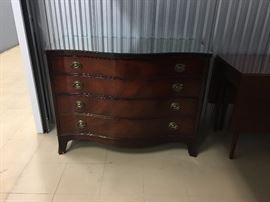 four drawer bow front chest by Drexel.  has glass on top