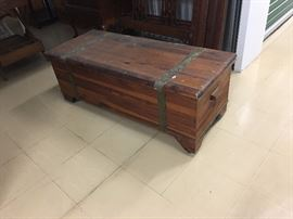 cedar chest, vintage, has wooden rollers.