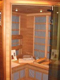 Sunlight cedar wood 5 person Far Infrared Corner Sauna, inside & out controls, lighting and Blaupunkt sound system  $2500 (Bids accepted above half price)