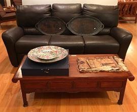 Natuzzi leather sofa.  Tapa cloth on table.