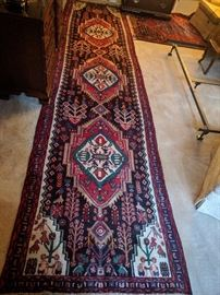 "Vintage Persian Karache runner, hand woven, 100% wool face, measures 4' x 16'-1""."