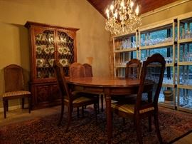 These people entertained a lot, have several sets of china and crystal stemware. This is their 1960's vintage Drexel Esperanto dining room set, consisting of a table with three leaves (with original pads) six side chairs, matching china cabinet and buffet.                                          The table is sitting on a Persian Bijar rug.                            The crystal chandelier is for sale, yes, thanks for asking!