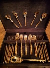 44-piece set of gold flatware, by International Silver Co., + mahogany chest.