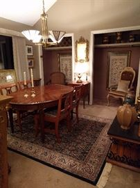 "I told you they liked to entertain, so here you see their second dining room.                                                                          This is where the ""B"" list sat, along with their weird uncle who lived in the basement. There is no basement in this house, so the uncle was REALLY weird.                                 The dining room table is vintage Henredon, the closeted chair is from the set of Pee-wee's Playhouse - Chairy! The framed fabric in each of the closets is from Norway."