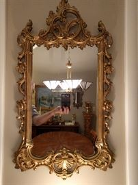 Sweet, little French gilt wood wall mirror - love tha hand!