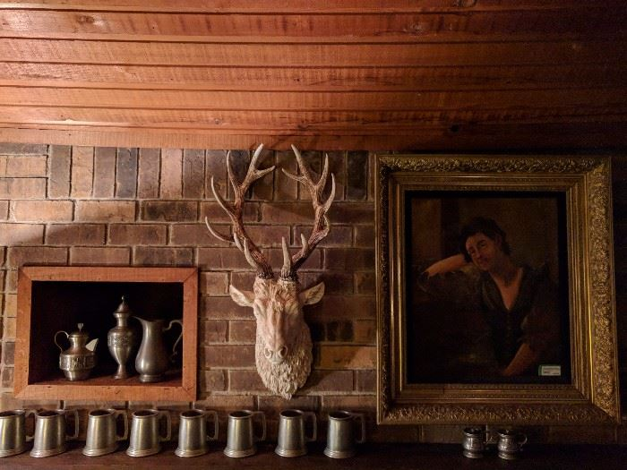 Now here's something you won't see everyday. A resin deer head, flanked on the left by a collection of vintage pewter and on the right by a beautifully framed oil portrait of a very homely woman, BUT it's from the Wrigley estate.