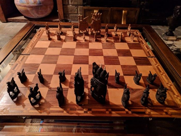 Very unique chess set - hand carved sandalwood pieces and well made board.