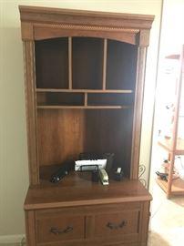 Matching shelf and file cabinet.