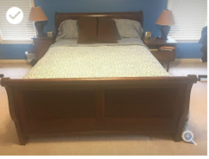 Bedroom set. Queen size bed with two end tables, dresser and mirror.
