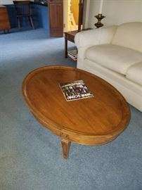 Overstuffed Neutral Sofa and Oval Wood Table