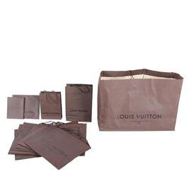 f8951c361922 Louis Vuitton Shopping Bags: A collection of thirteen brown Louis Vuitton  shopping bags. The